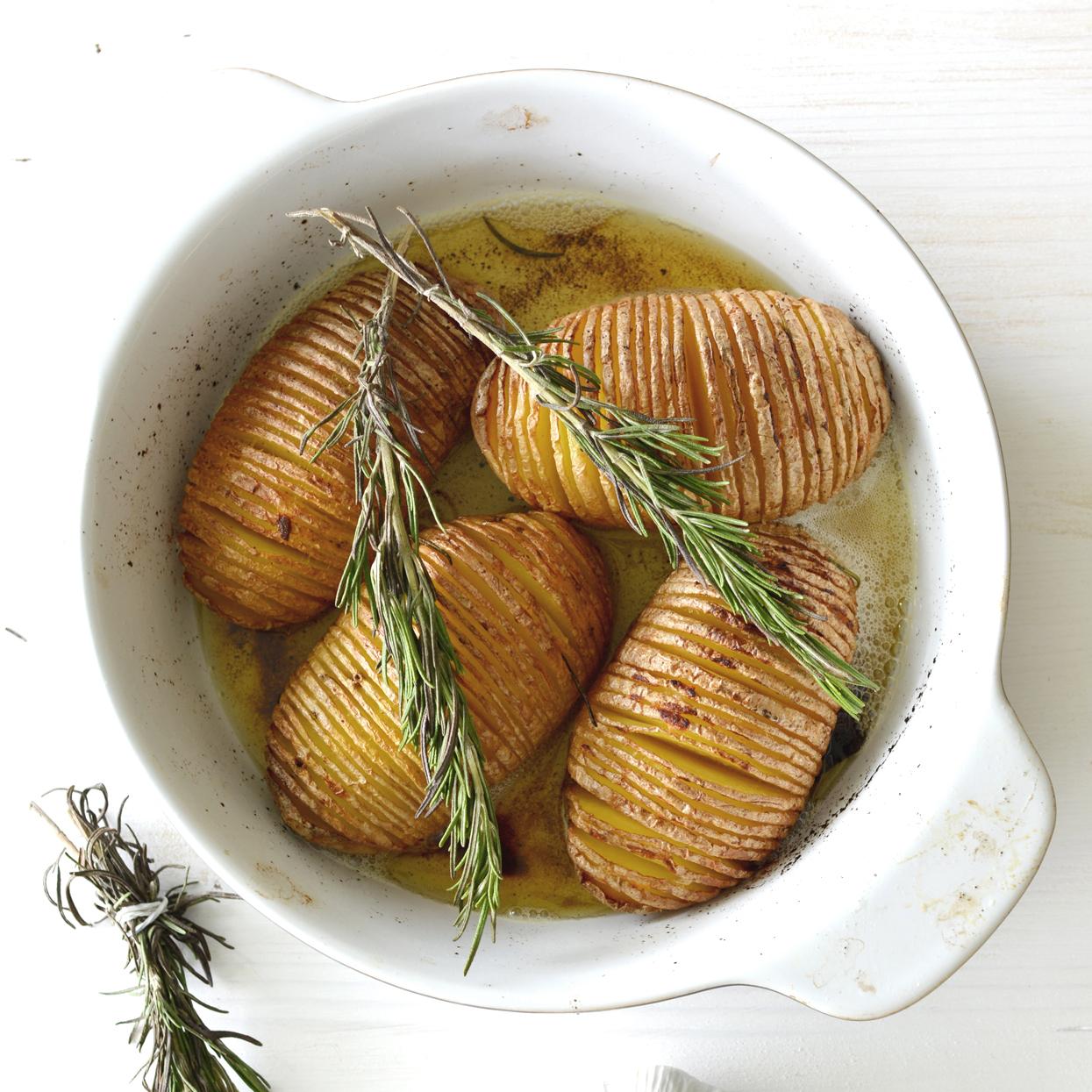 Garlic and Rosemary Roasted Hasselback Potatoes Lauren Caris Cooks