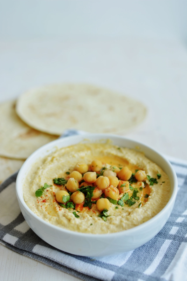 This simple hummus recipe is the only one you'll ever need in your kitchen! Creamy, delicious and super easy! From Lauren Caris Cooks