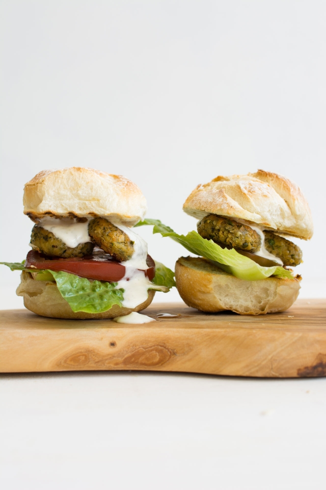 Easy, homemade falafel, stuffed into the most delicious burgers you'll ever have. Healthy, vegetarian and so easy, you can have it on the table in under 40 minutes! From Lauren Caris Cooks