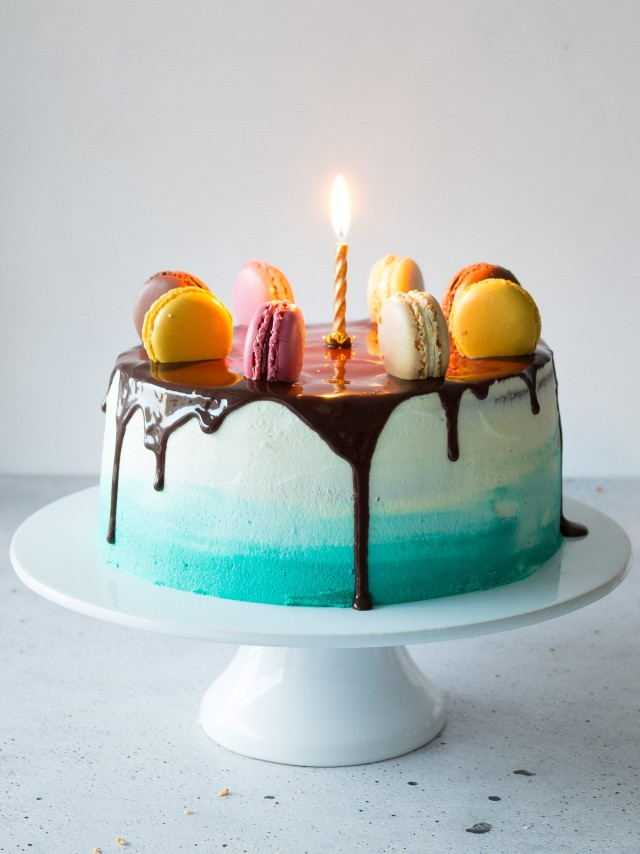 A deliciously moist Vanilla layer cake filled with vanilla buttercream frosting and topped with a rich chocolate ganache. This is a centre piece cake you just can't ignore
