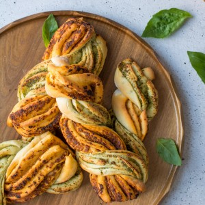 These delicious and easy two tone pesto bread twists will make any meal more interesting! Perfect for dipping in soup! Watch our video tutorial to see just how ridiculously easy it is to make these!