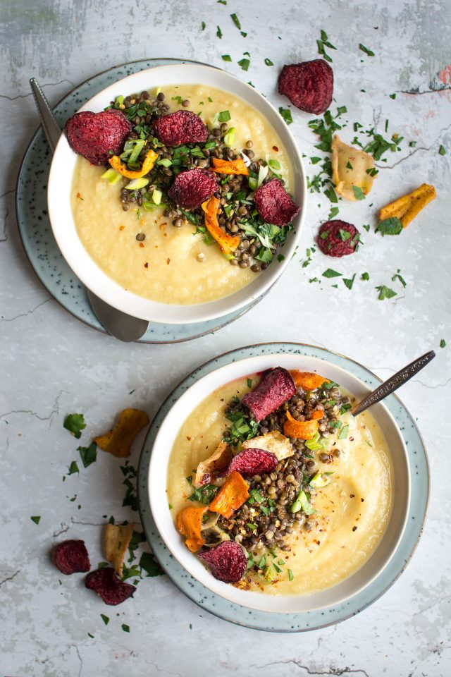 A delicious, sweet parsnip and apple soup, loaded with lentils and roasted vegetable crisps