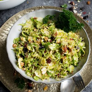Raw Brussels Sprouts Salad with Dried Fruit served in a baked avocado!