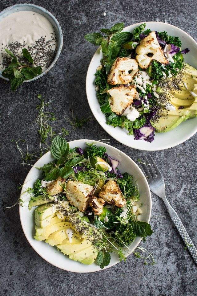 Start off the year with a simple roasted cauliflower detox bowl with a creamy, tahini sauce!