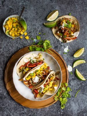 These vegan bean tacos only take one tray and are served with the freshest, zingiest mango salsa!