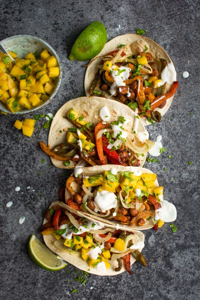 These vegan bean tacos only take one tray and are served with the freshest, zingy-est mango salsa!