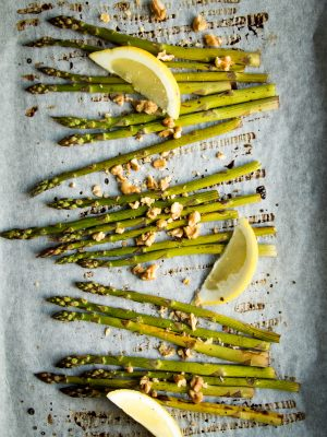 Make the most of this beautiful, seasonal asparagus by roasting it in balsamic vinegar and lemon juice!