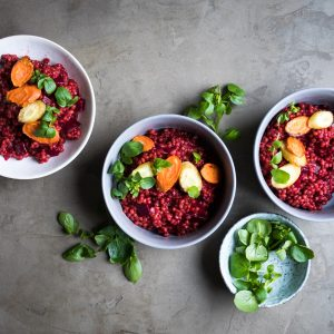 An earthy barley risotto cooked with beetroot and roasted carrots