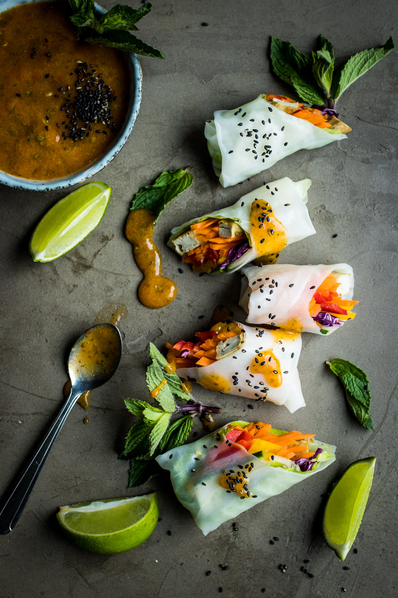 You'll love these vegan summer rolls with a fresh mango dipping sauce and a creamy peanut butter dipping sauce perfect New Year's Eve Recipe Ideas for a holiday party!